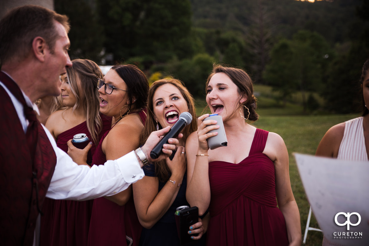 Wedding guests singing with the DJ.