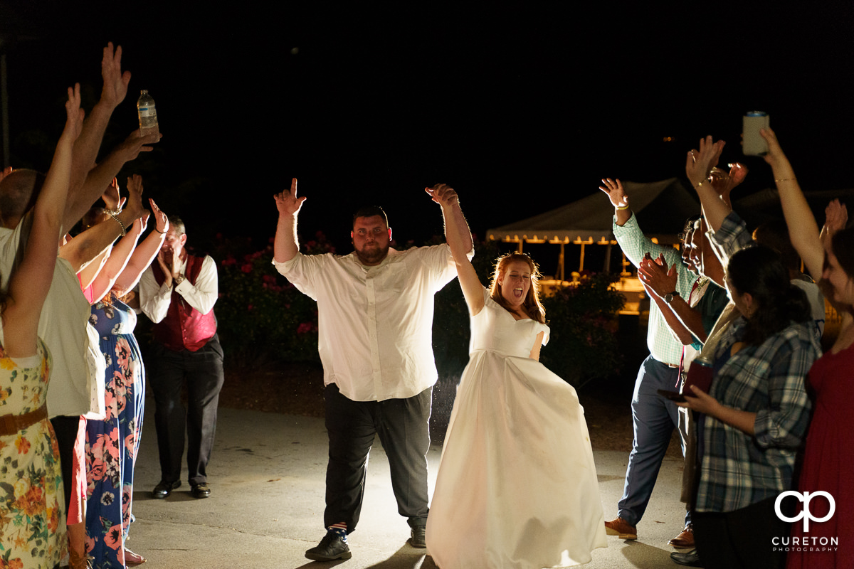 Groom and bride making a grand exit.