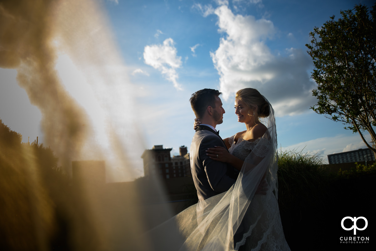 Bride and groom on a rooftop after their wedding at Avenue in Greenville,SC.
