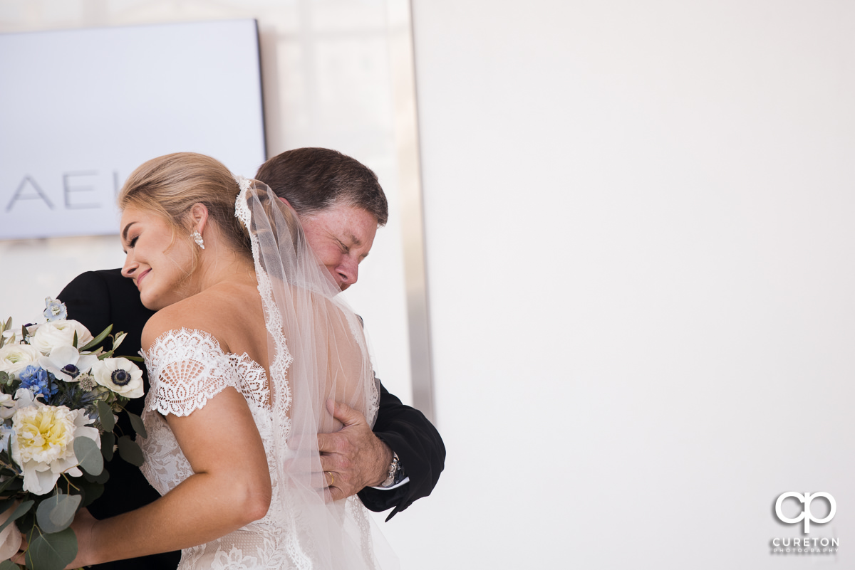 Bride hugging her dad during first look at Avenue in Greenville,SC.