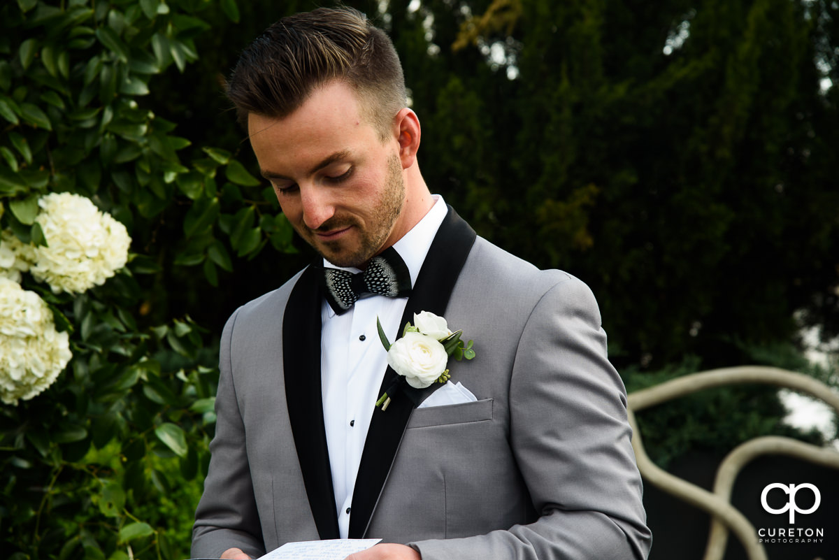 Groom reading a note before the ceremony.