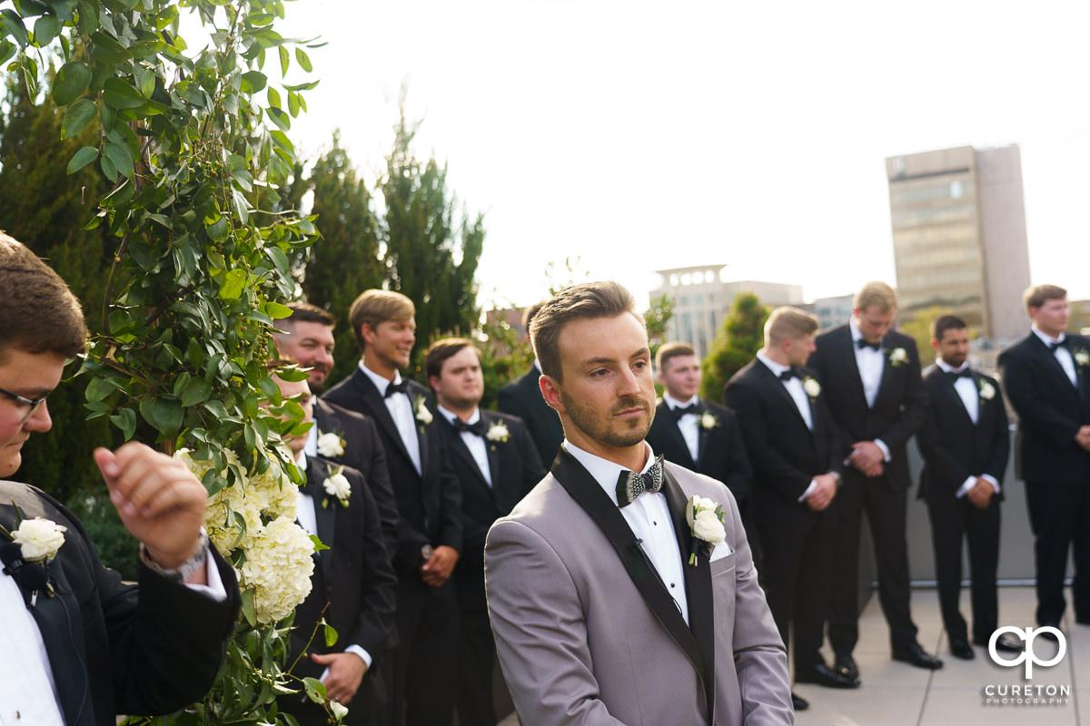 Groom seeing his bride walking down the aisle.