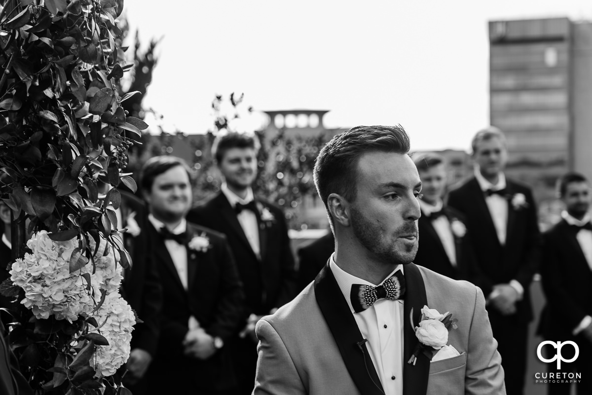 Groom seeing his bride for the first time on their wedding day.