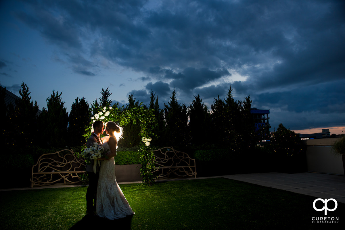 Bride and groom dancing at sunset on the rooftop at their wedding reception at Avenue in Greenville,SC.