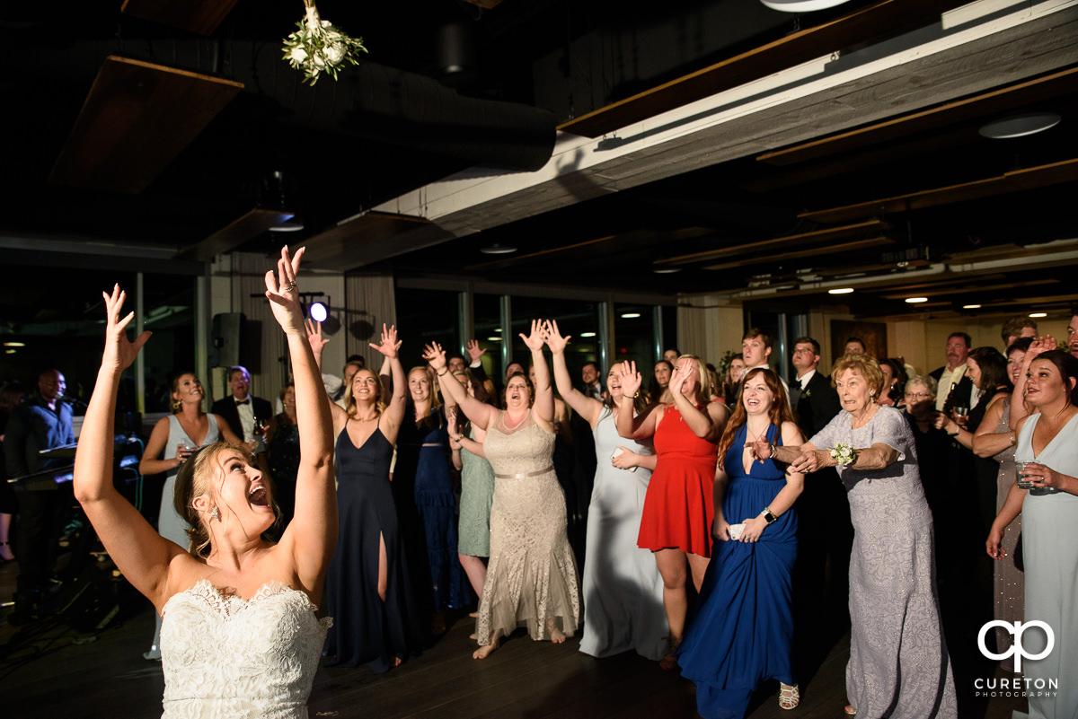 Bride tossing her bouquet.