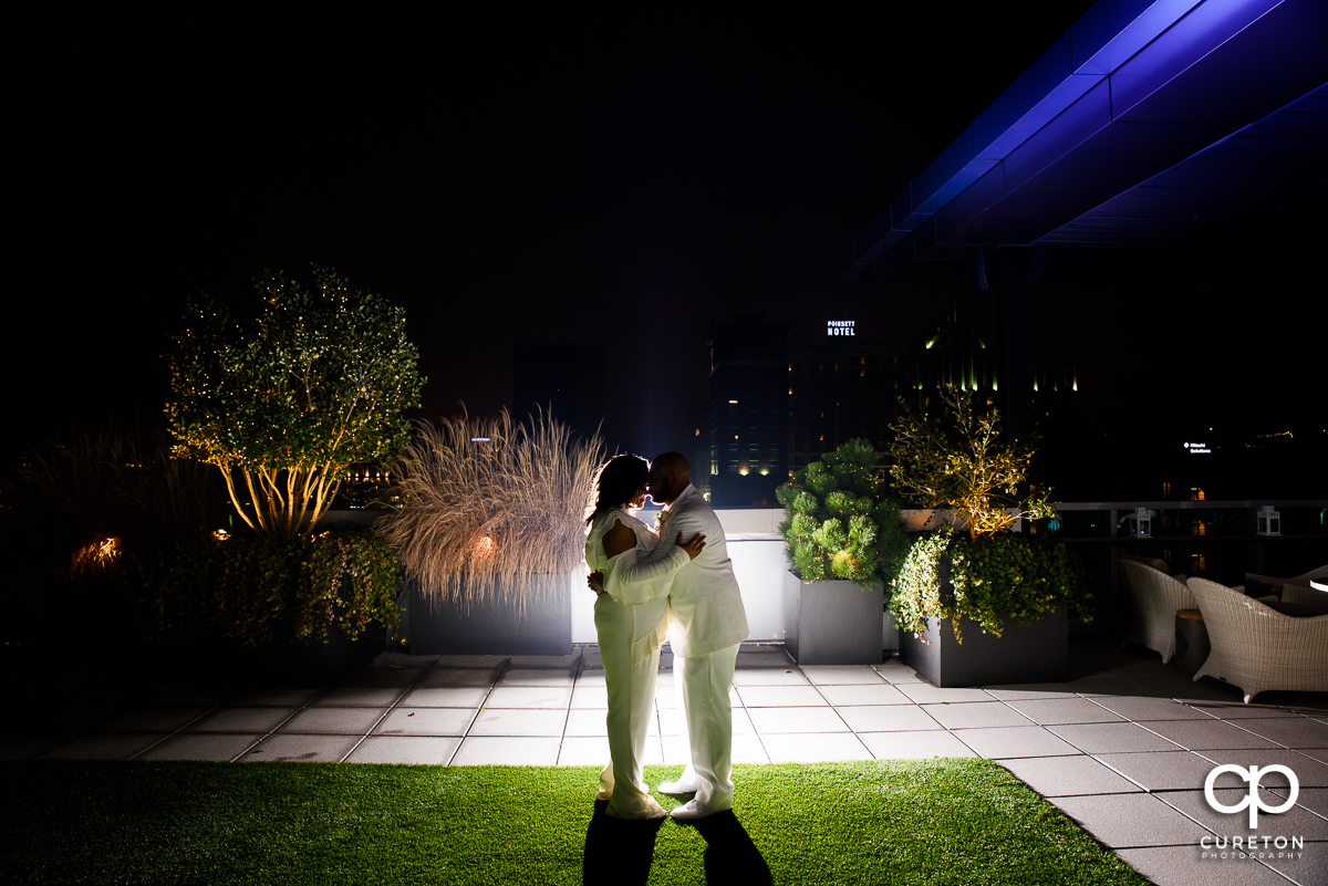 Bride and groom on the rooftop after their wedding at Avenue in downtown Greenville,SC.