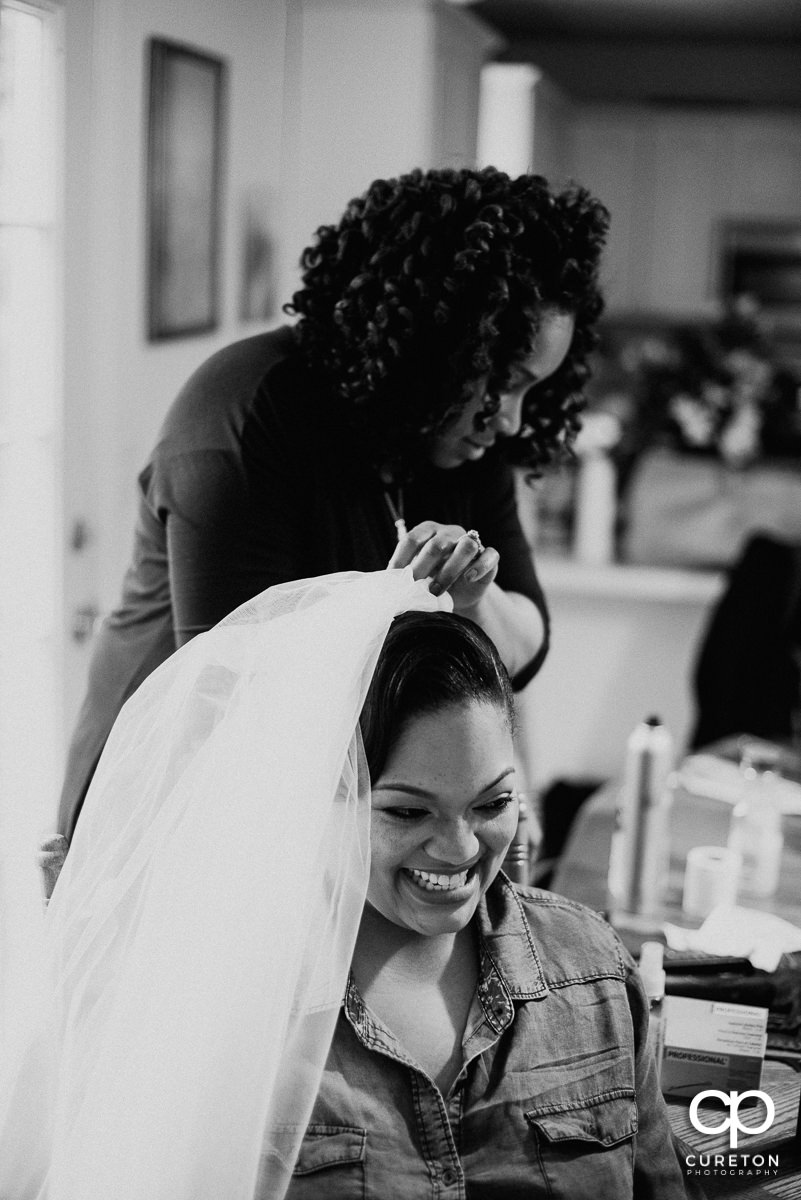 Bride putting her veil in.