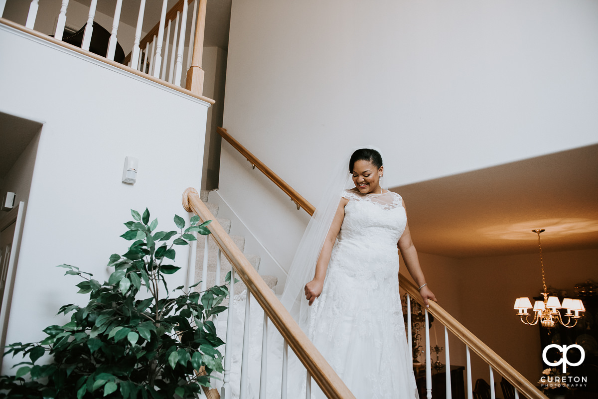 Bride on the staircase at her mother's house.