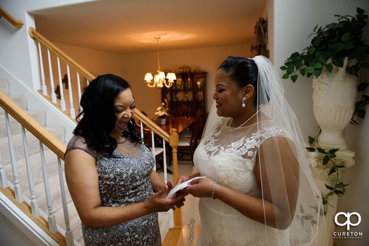 Bride giving her mother a gift.