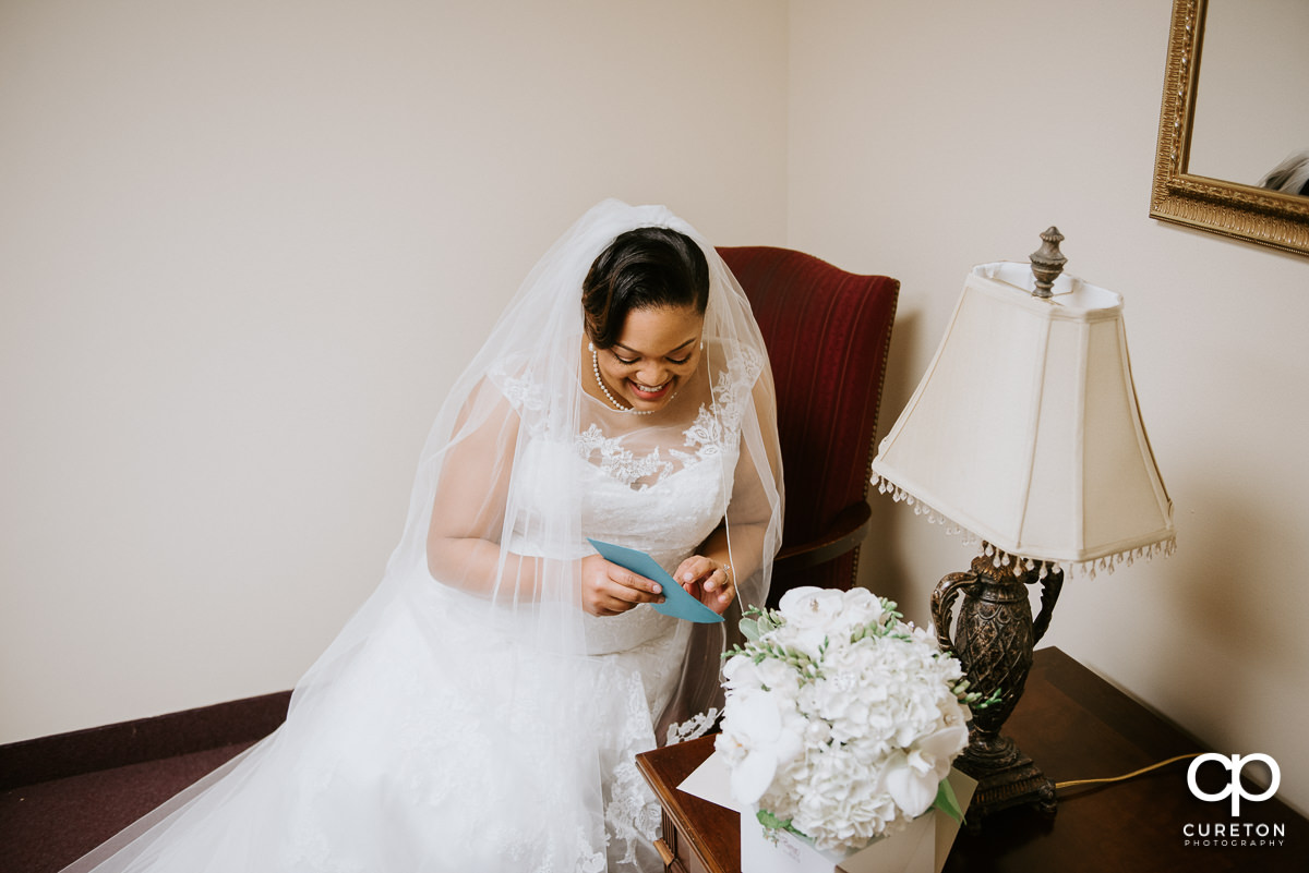 Bride opening a letter from her soon to be husband.