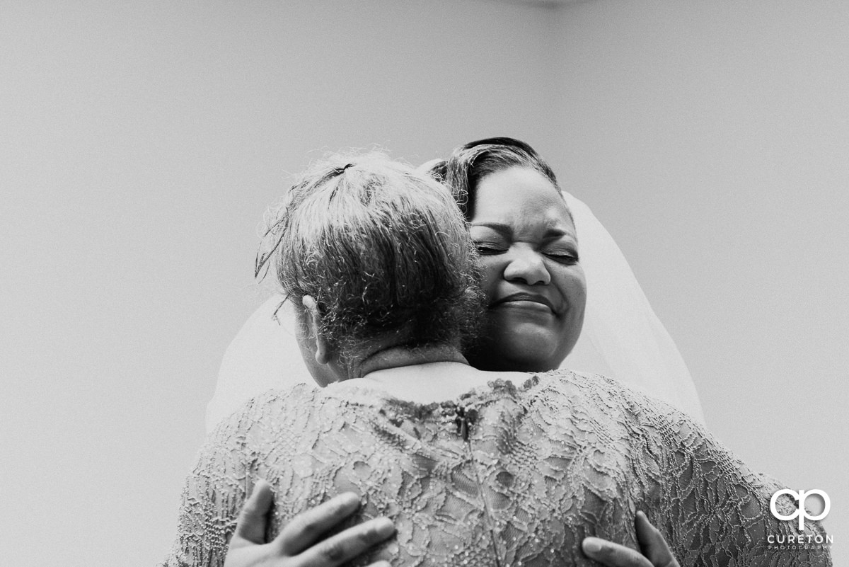 Bride and her grandmother hugging before the ceremony.