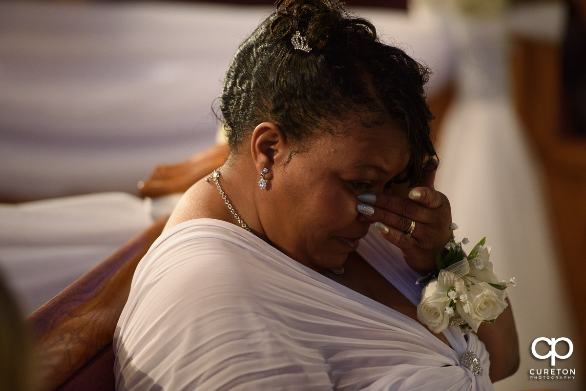 Groom's mother crying at wedding.