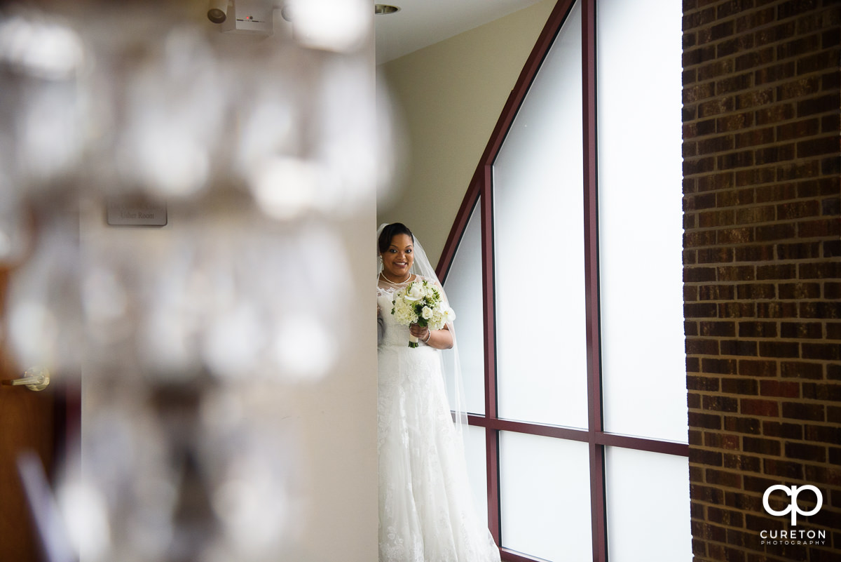 Bride getting ready to walk down the aisle at her wedding ceremony.