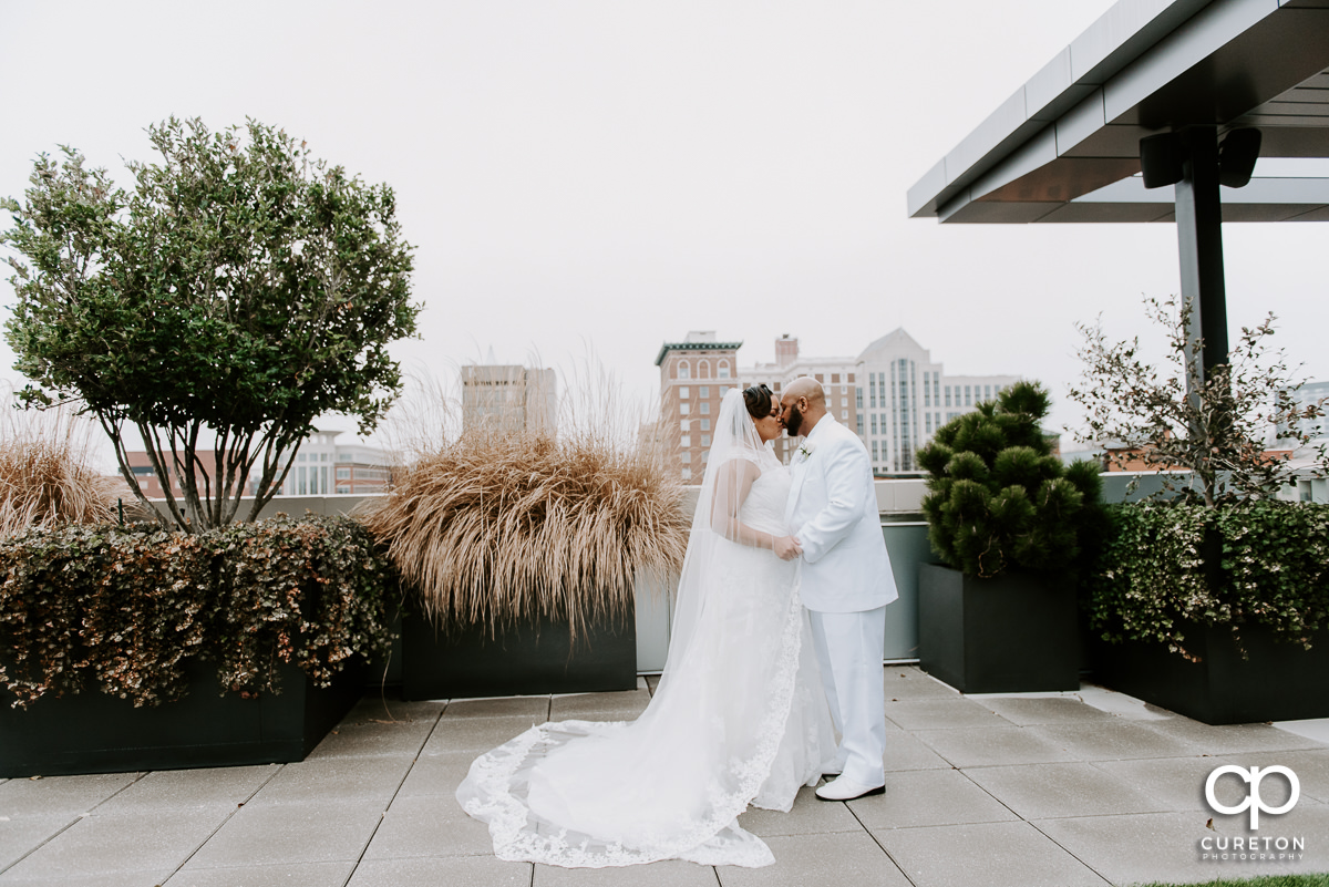 Bride and groom dancing on the rooftop patio at their Avenue Greenville wedding.