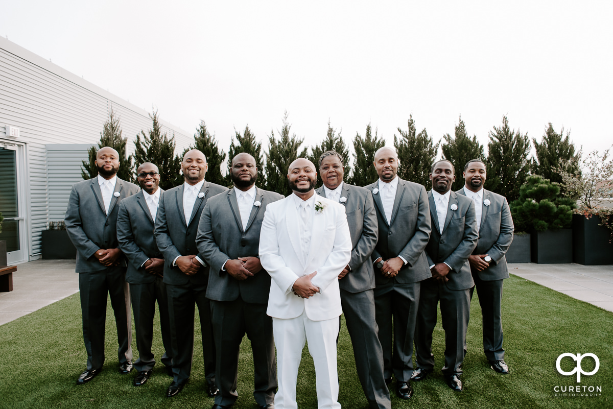 Groom and groomsmen before the wedding reception at Avenue Greenville.