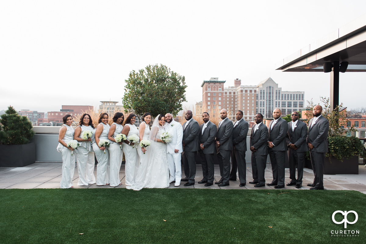 Wedding party on the rooftop facing the downtown Greenville,SC skyline.