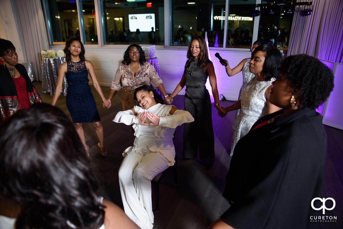 Bride being serenaded by her sorority.