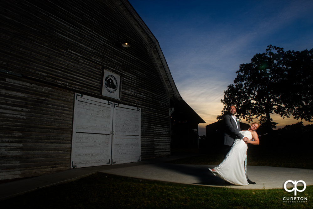 Bride and Groom dancing at sunset after their wedding at The Barn at Forevermore Farms.