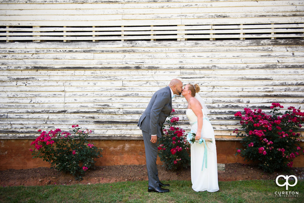 Bride and groom kissing after their wedding at The Barn at Forevermore Farms.