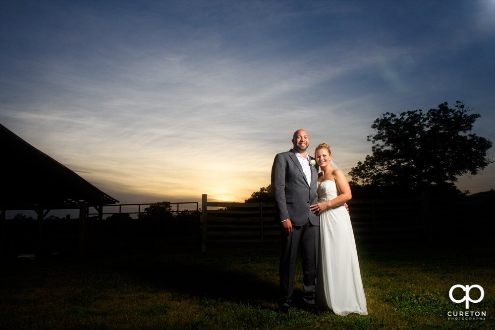 Bride and groom at sunset after their rustic farm wedding.