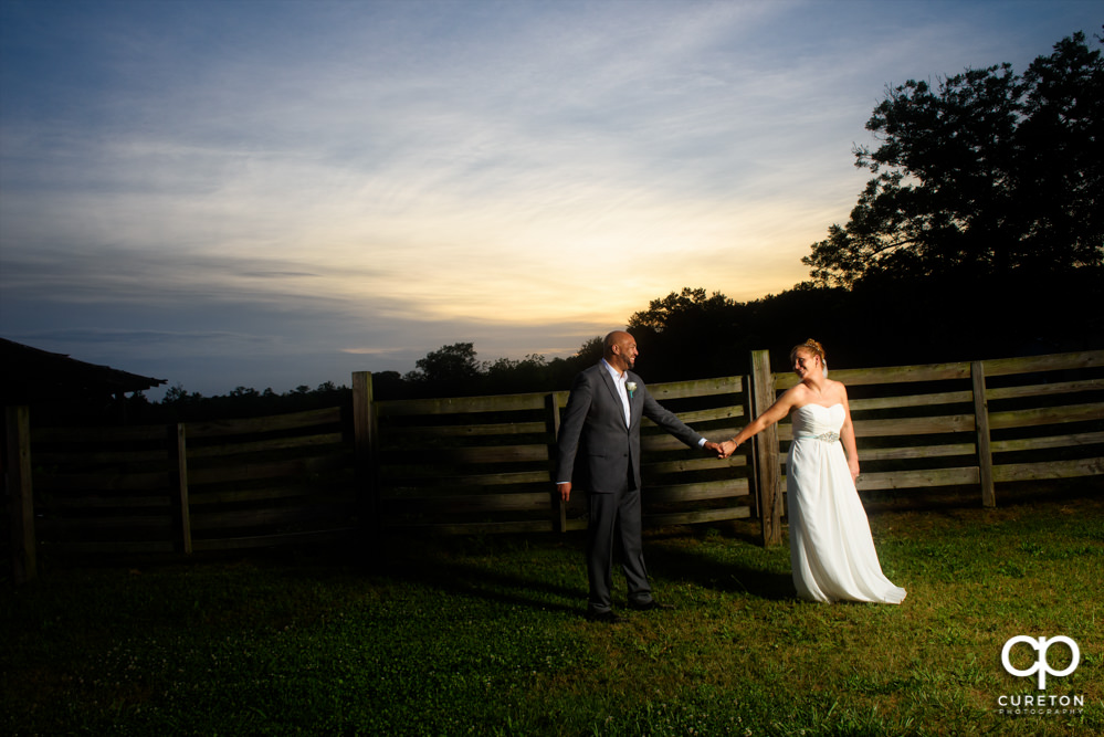 Bride and groom at sunset after their wedding at The Barn at Forevermore Farms.