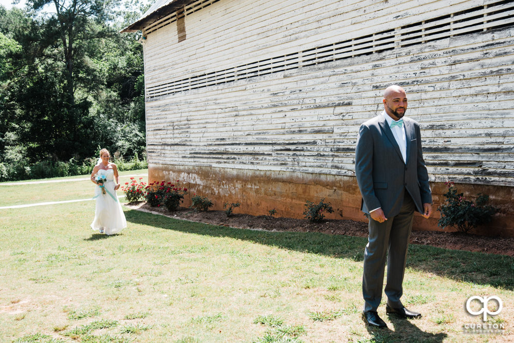 Bride and groom having a first look before their Barn at Forevermore Farms wedding.