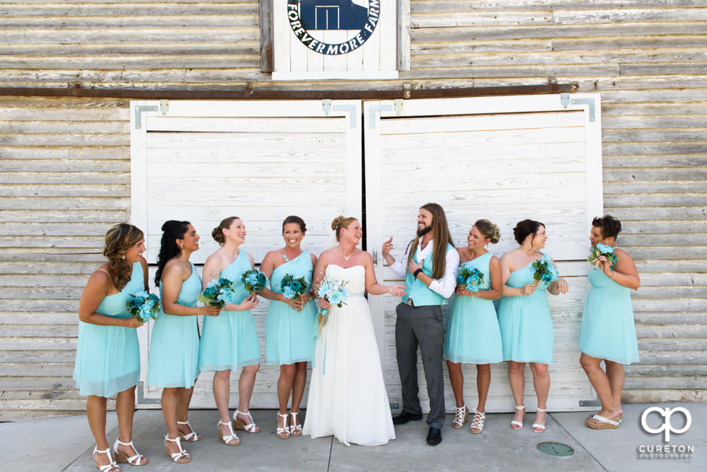 Bride and bridesmaids in front of the barn.