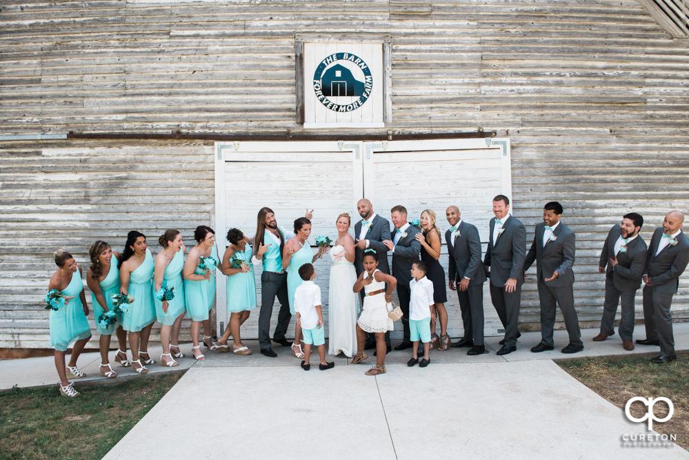 Wedding party in front of the barn door.