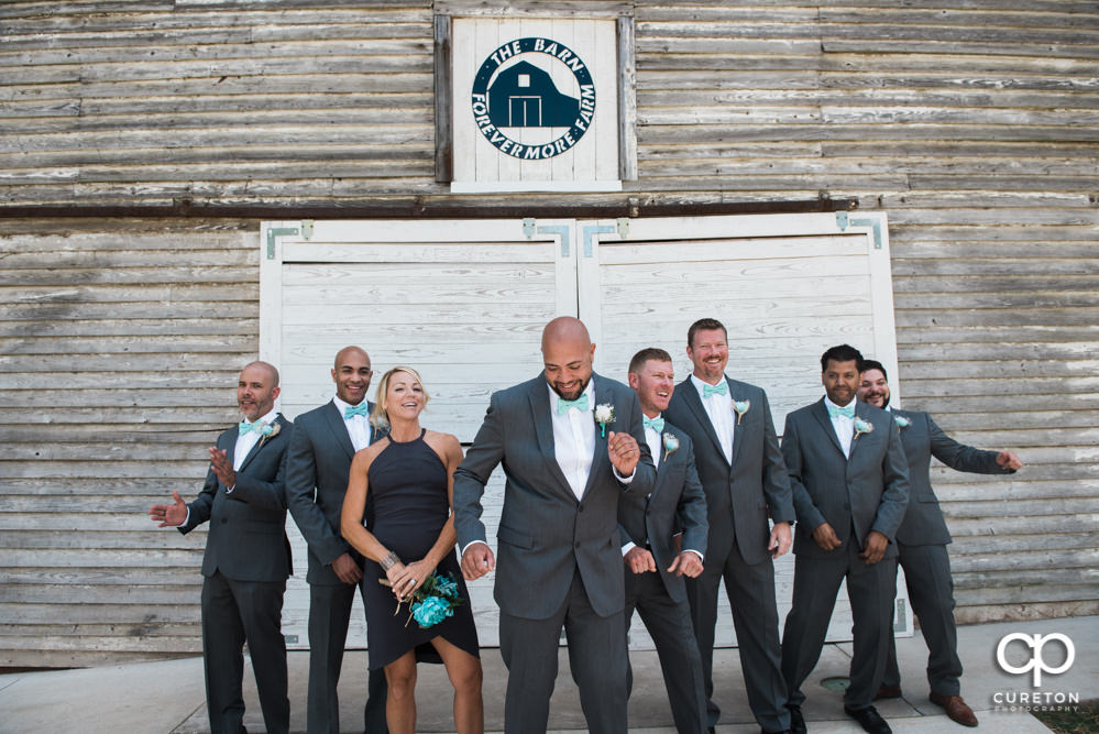 Groom and groomsmen in front of the barn.