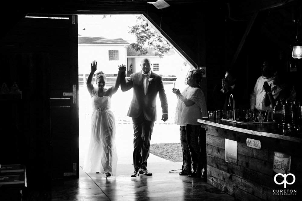 Bride and groom making an entrance.