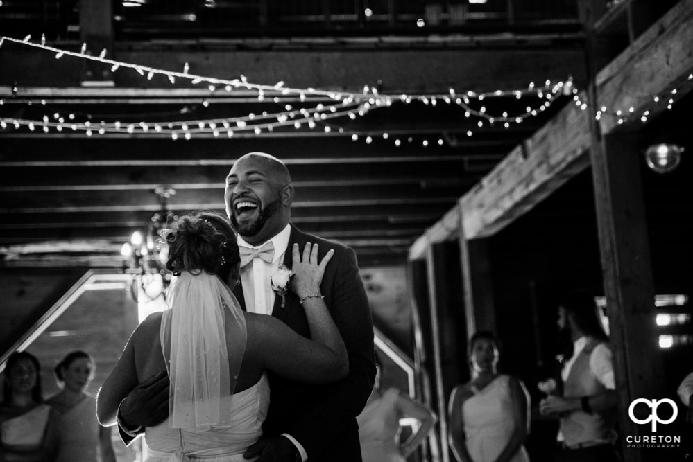 Bride and groom first dance at their wedding reception at The Barn at Forevermore Farms.
