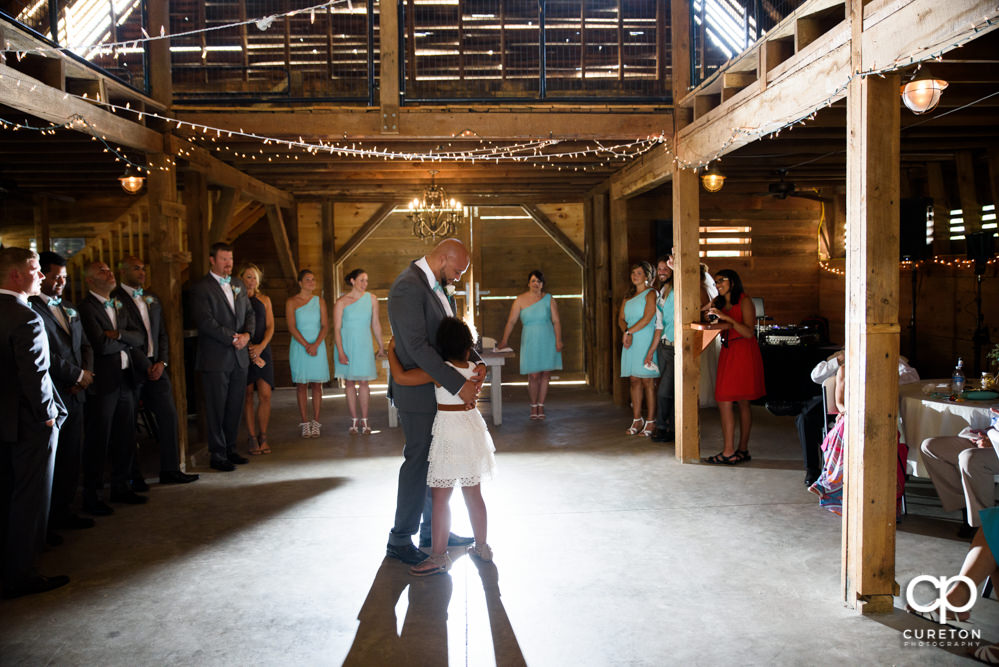 Groom dancing with his daughter at the wedding reception at The Barn at Forevermore Farms.