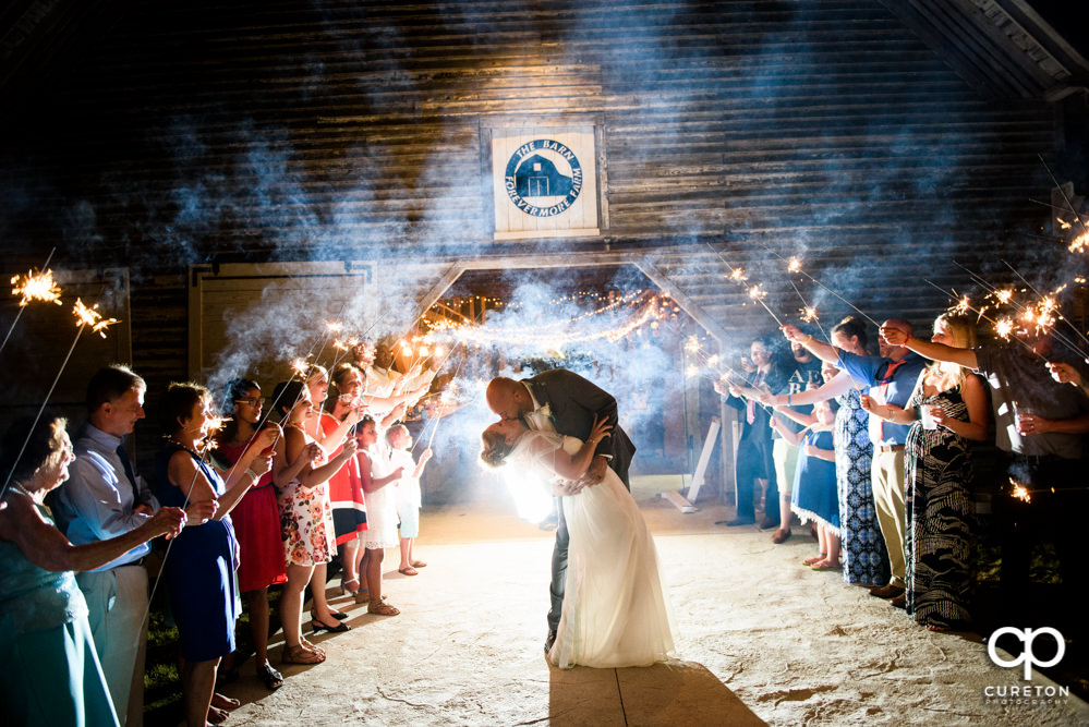 Sparkler grand exit after the wedding at The Barn at Forevermore Farms.