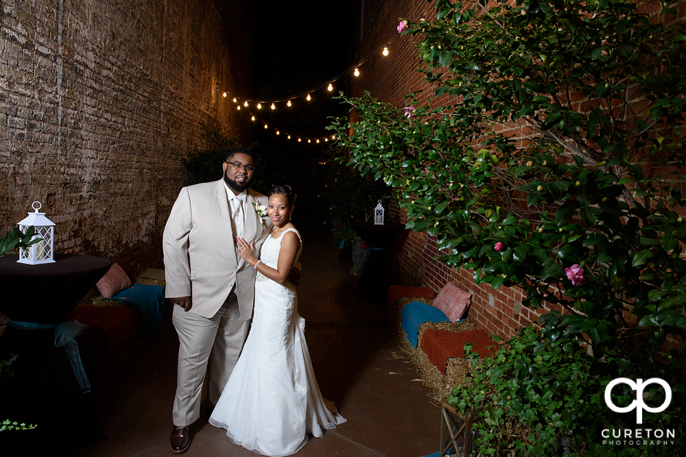 Bride and groom in the alley at the Bleckley Inn.