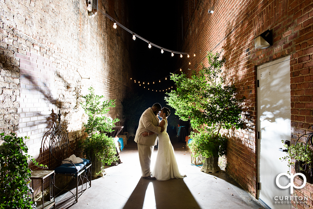 Epic pose of bride and groom after their Bleckley Inn wedding.