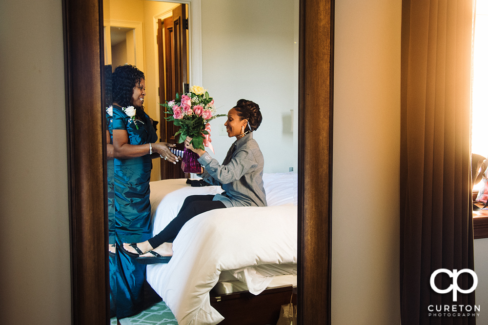 The bride received flowers from her groom before the wedding.
