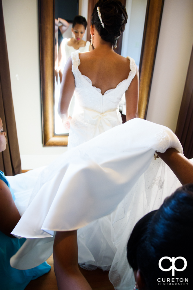 The bride getting into her dress.