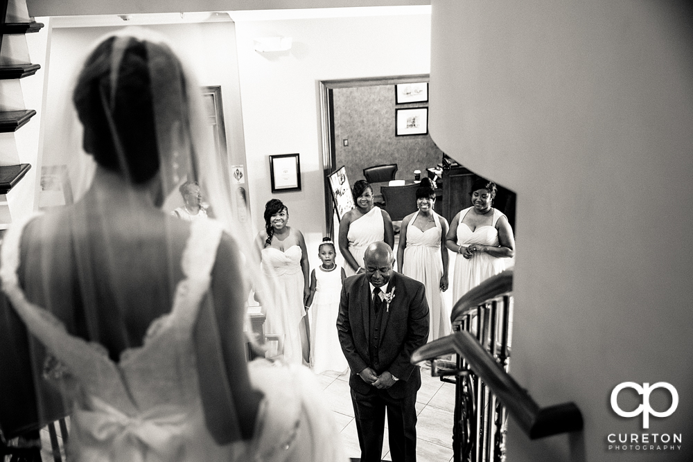 Bride doing a first look with her father.