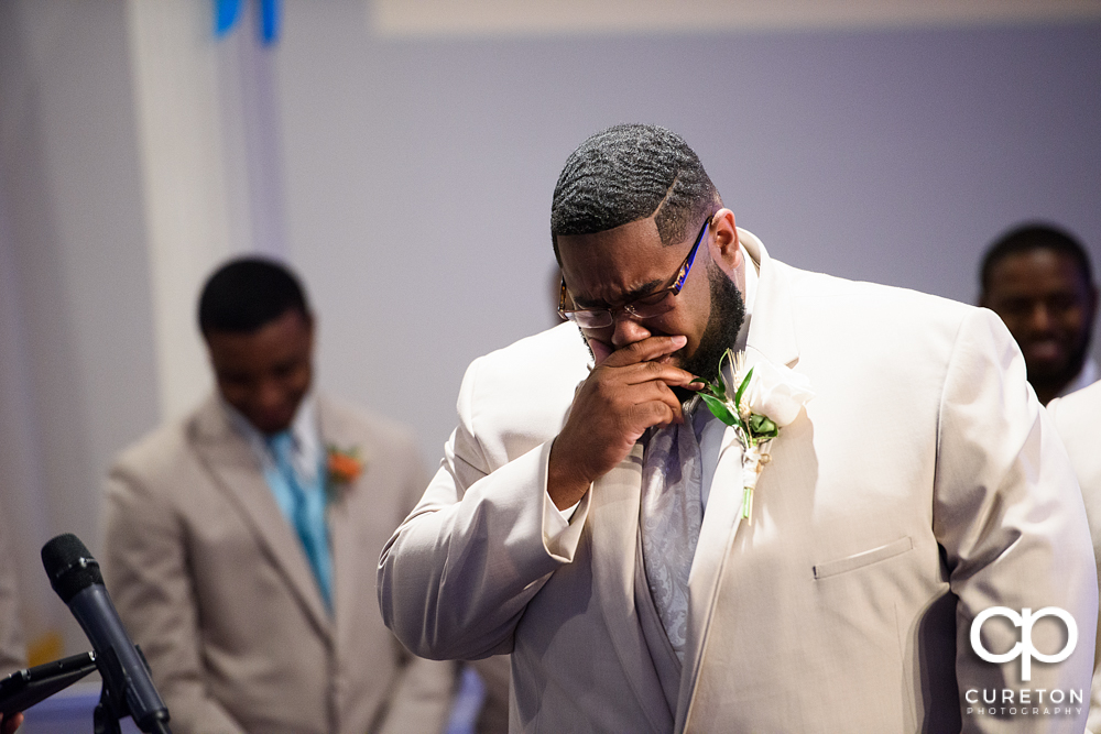 Groom cries when he sees his bride for the first time walking down the aisle.