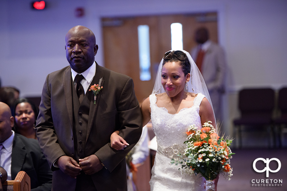 Bride and her father walking down the aisle.