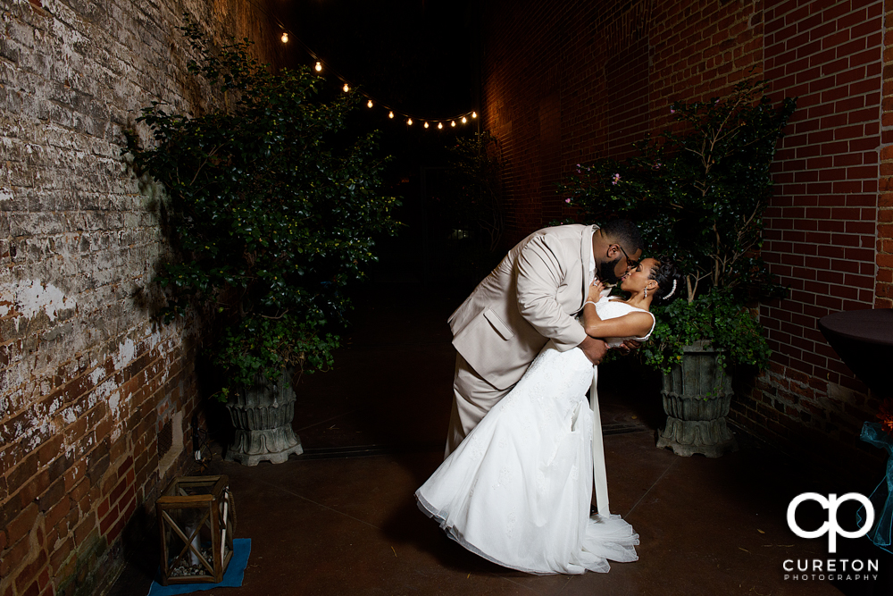 Bride and groom dancing in the alley of the Bleckley Inn.