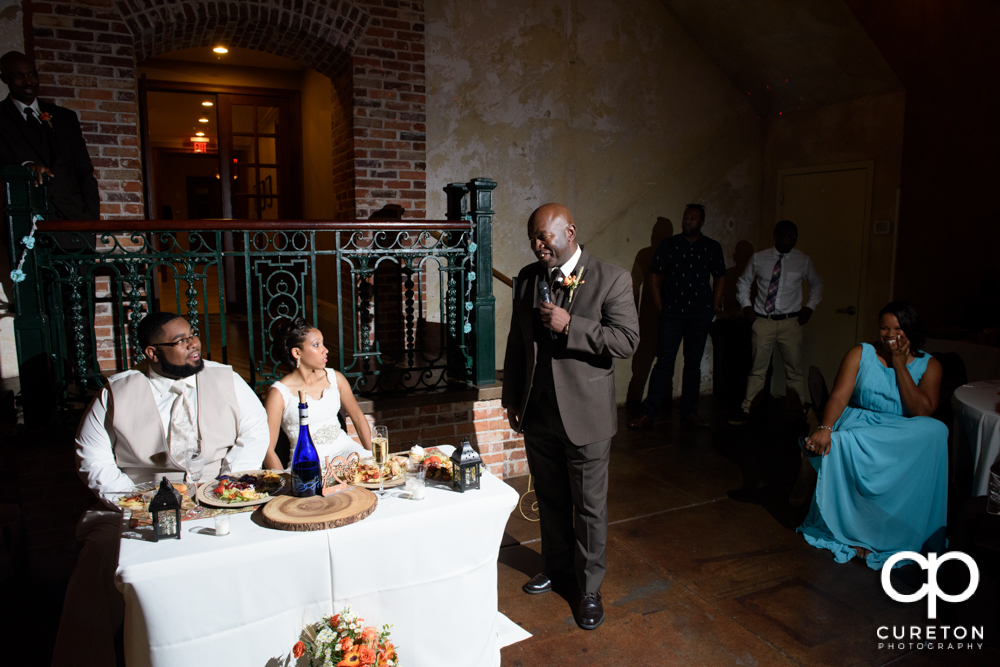 The best man and maid of honor giving toasts.
