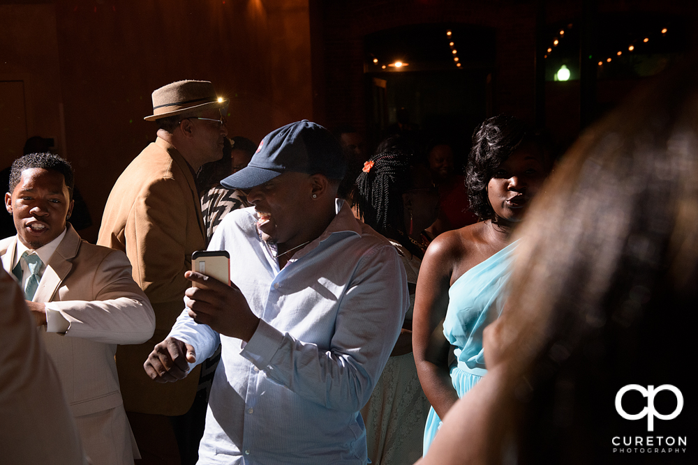Wedding guests dance at the Bleckley Inn to the sounds of DJ Fresh.