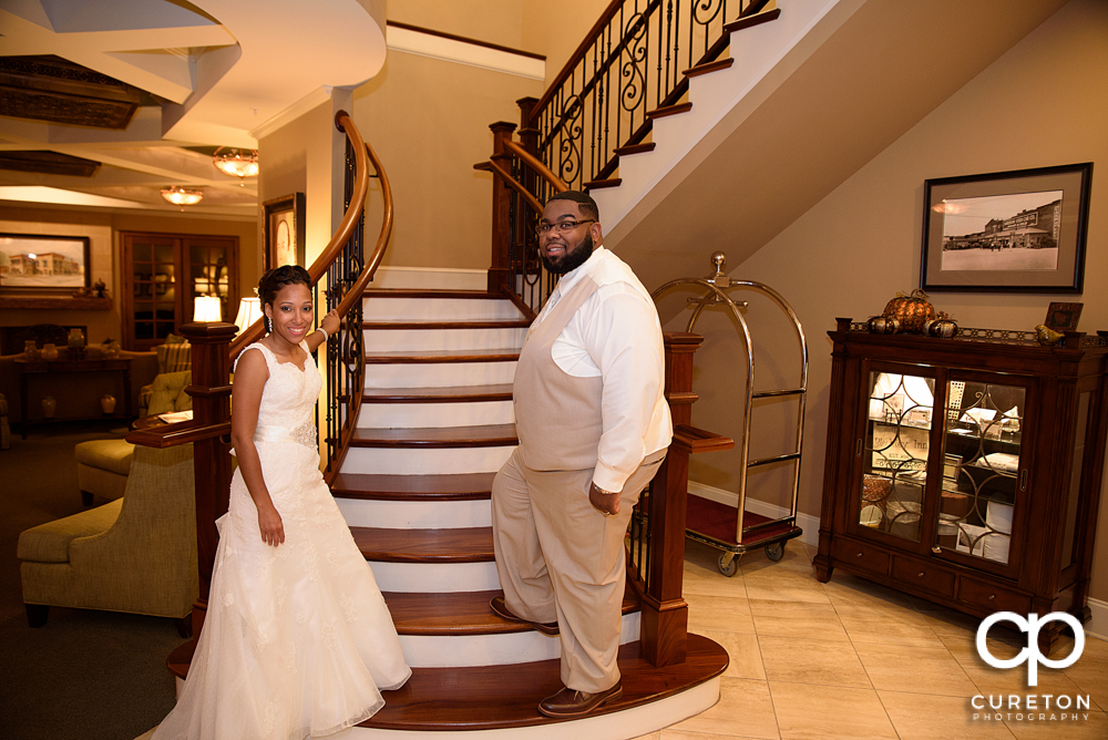 The bride and groom going upstairs.