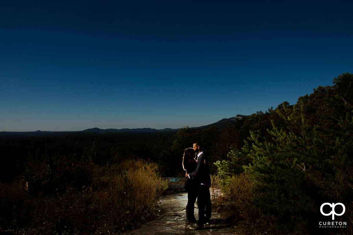 Bride and groom silhouetted at Bald Rock.