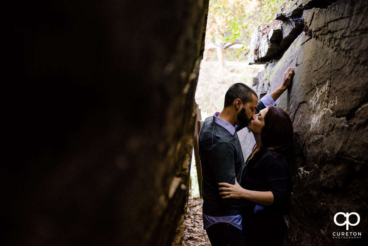 Brie and groom kissing during a Caesar's Head Engagement Session.