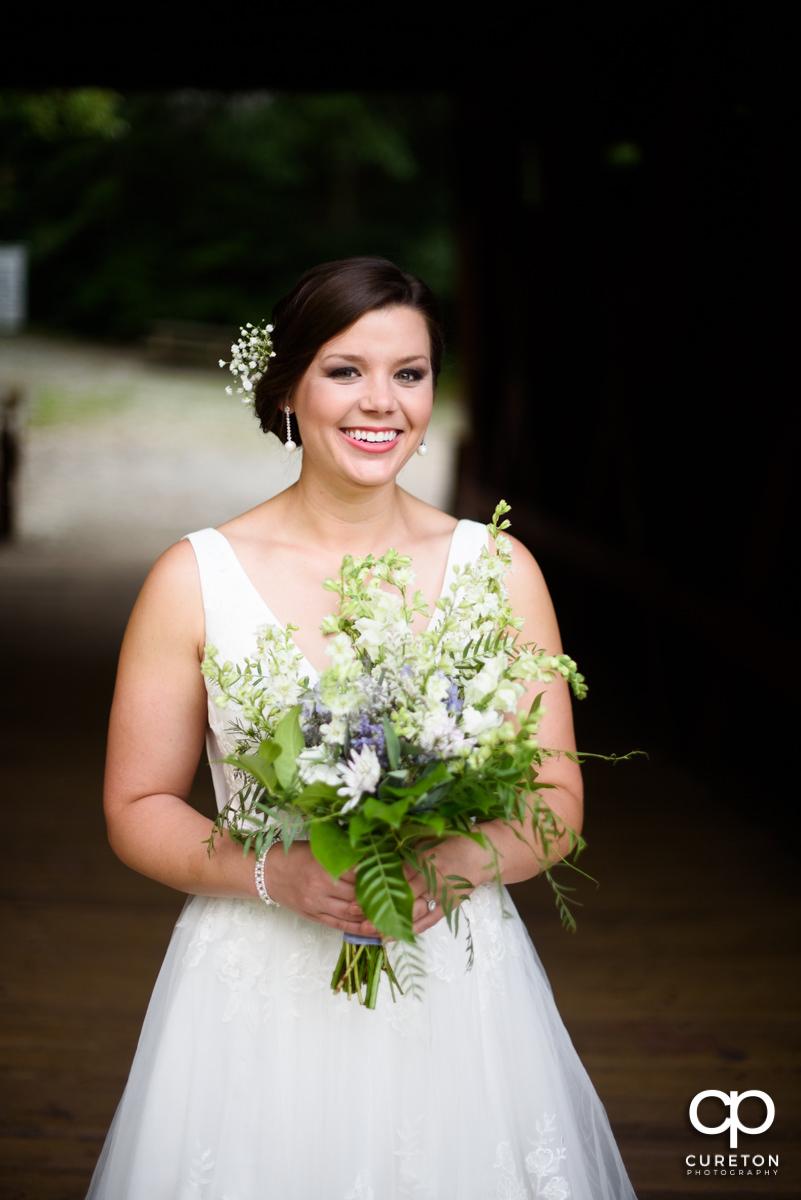 Bride holding a bouquet.