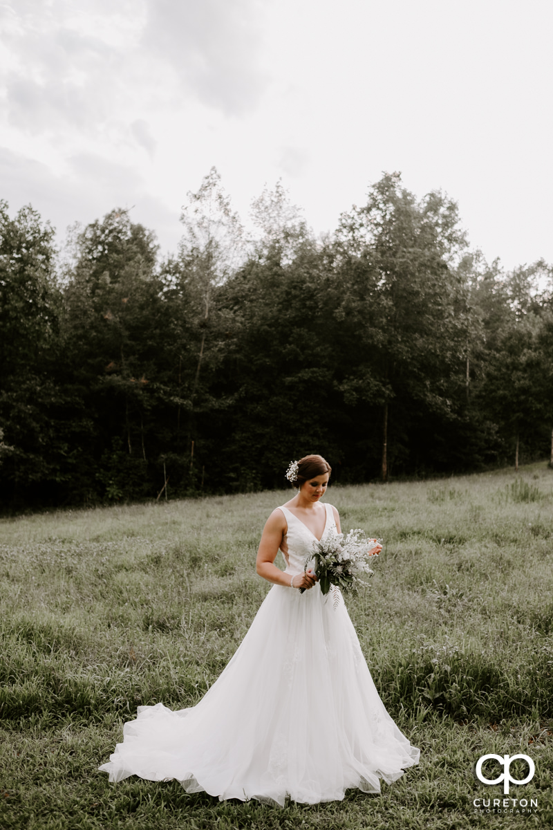 Bride holding her flowers in a field in Greer,SC.