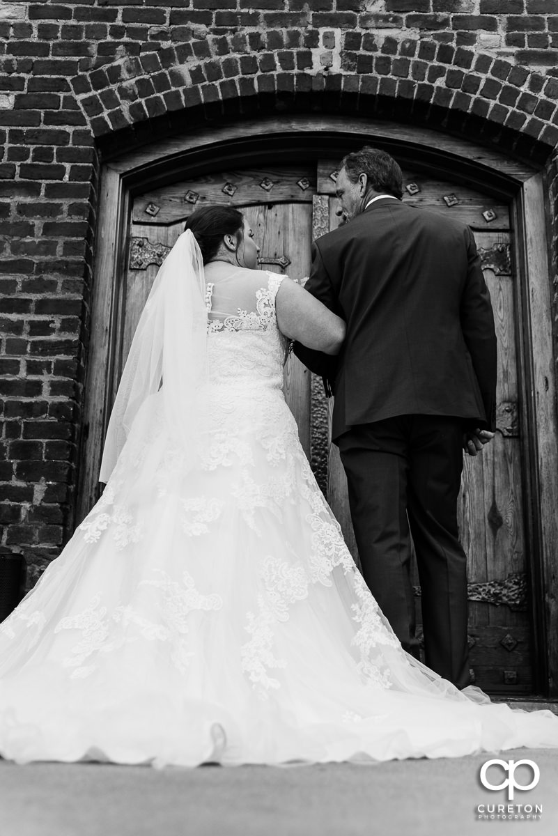 Bride and her father getting ready to walk down the stairs at The Old Cigar Warehouse in downtown Greenville before the wedding ceremony.