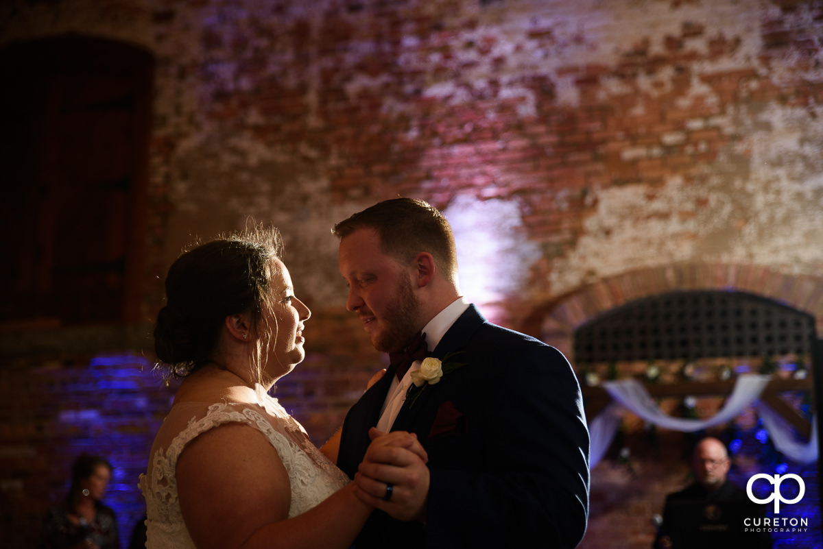 Bride and groom first dance at the wedding reception in Greenville at The Old Cigar Warehouse.